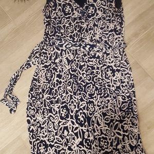 Navy and white print sleeveless dress.